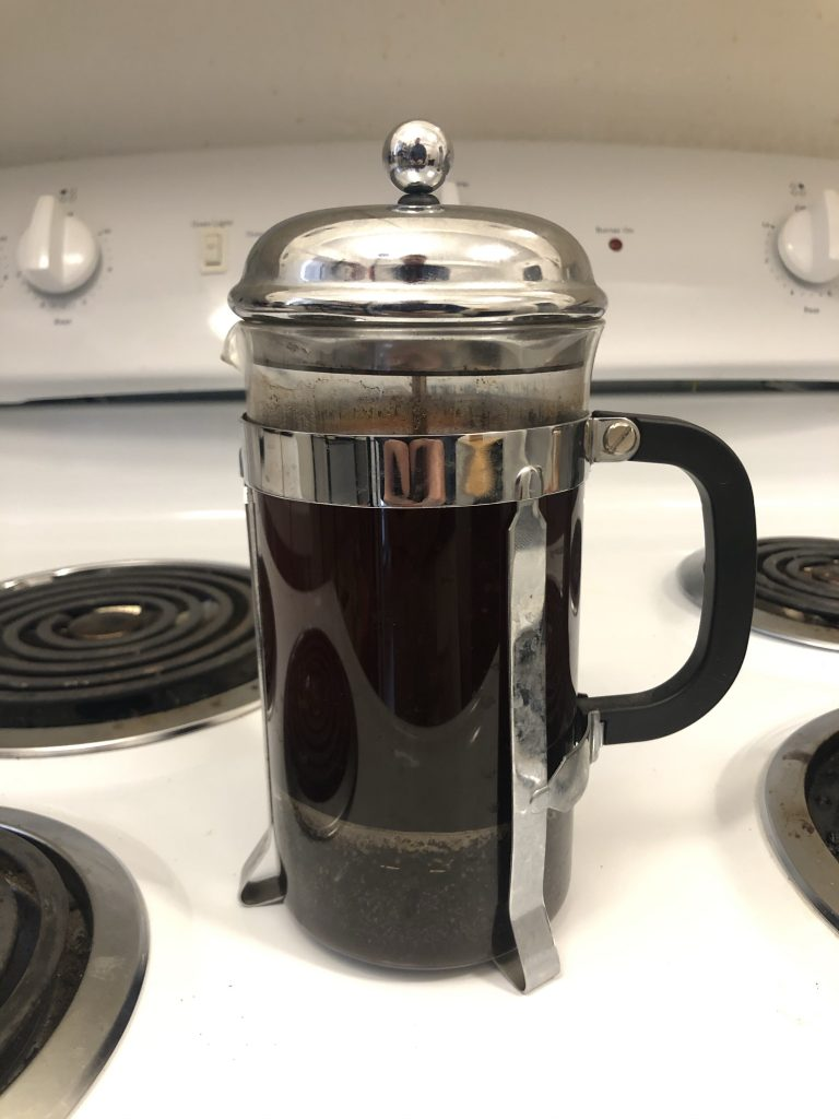 cold brew coffee in french press after plunger is pushed
