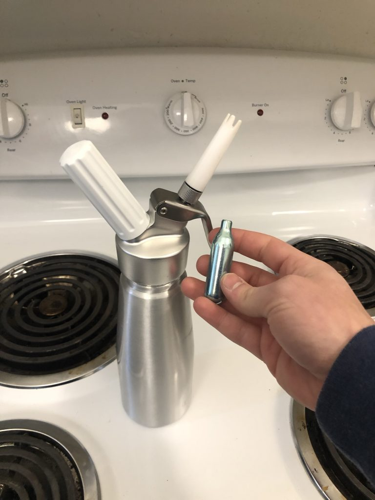 nitrogen cartridge with nitro maker. An easy step to make nitro cold brew at home