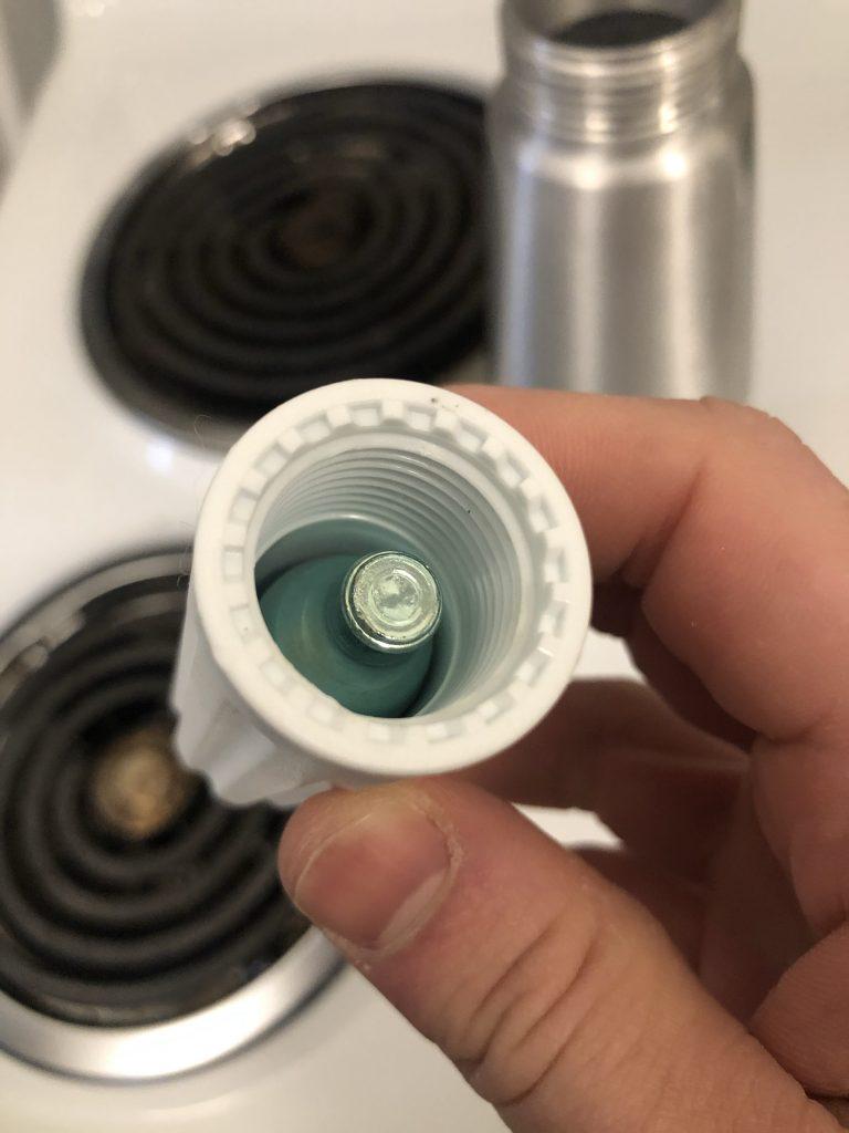nitrogen cartridge inside white cap