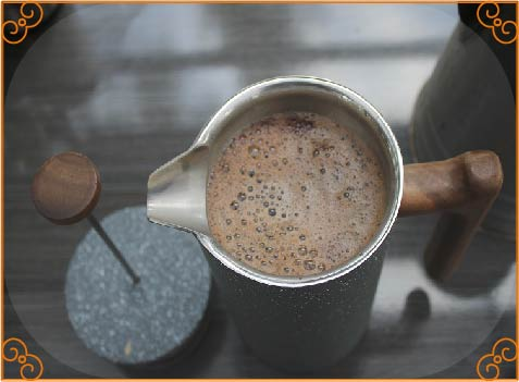 ground coffee with near-boiling water 2