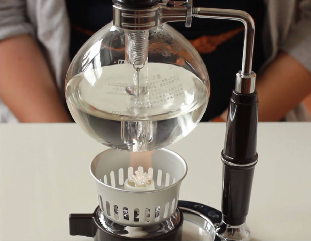 siphon brewing vessel with boiling water and coffee filter