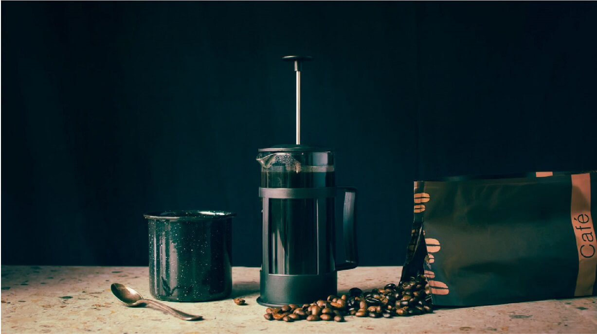french press with coffee beans pack and cup