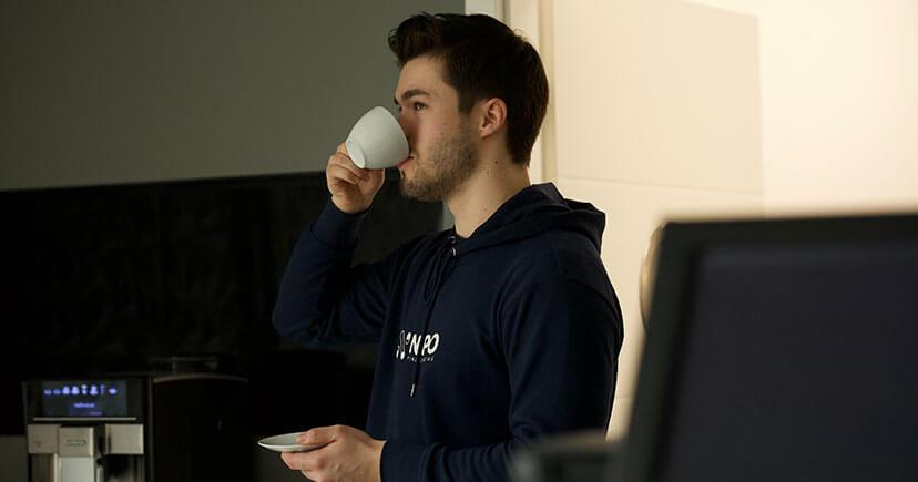 A healthy man drink coffee