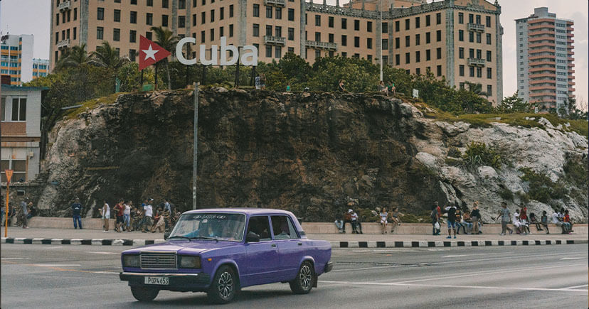 Blue old car on cuba road