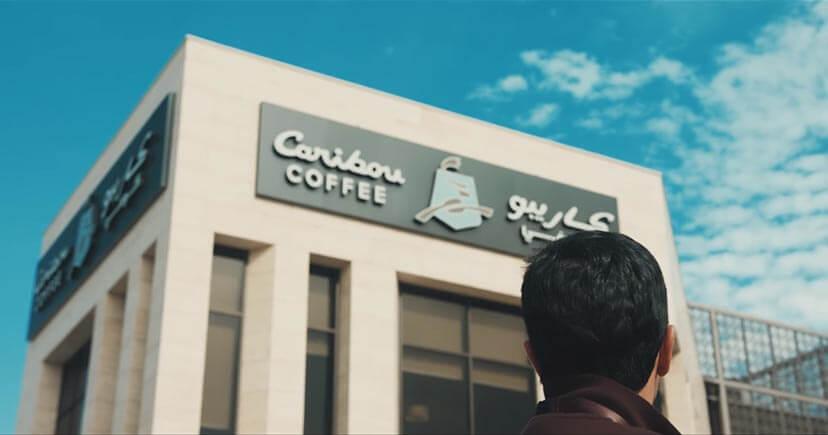 A man see Caribou coffee shop