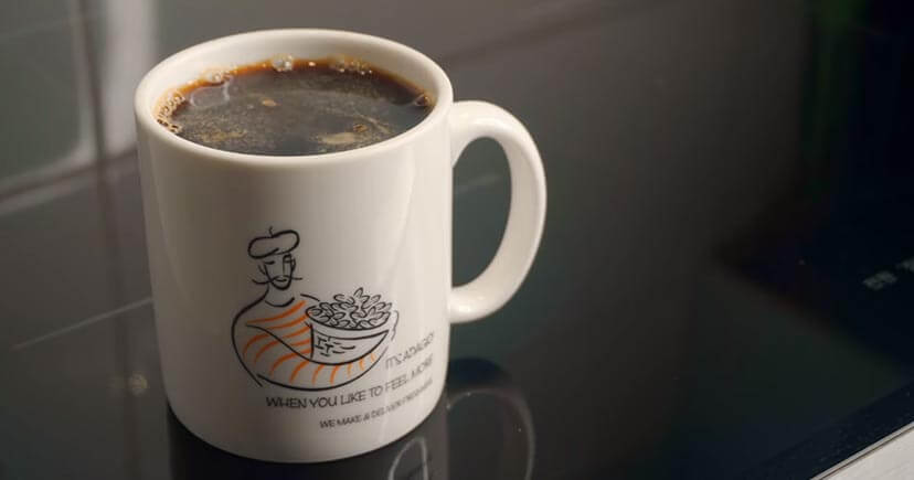 Black eye coffee cup on wood table