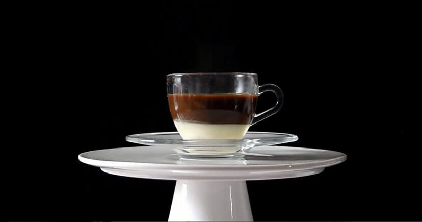 Cafe Bombon in cup with black background