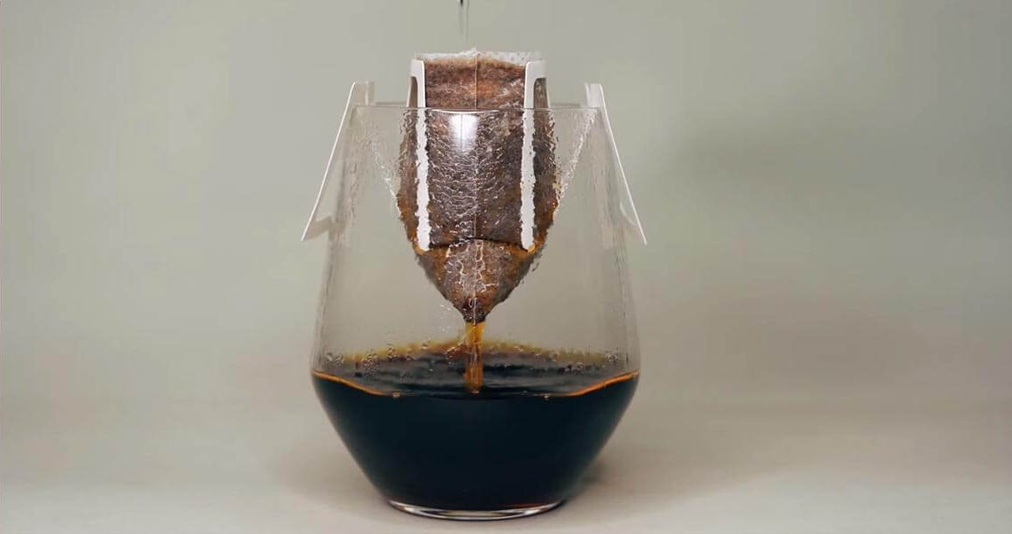 coffee bag brewing in cup on white table