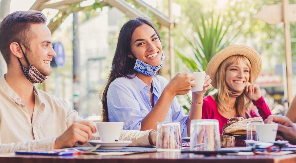 Western people enjoying coffee