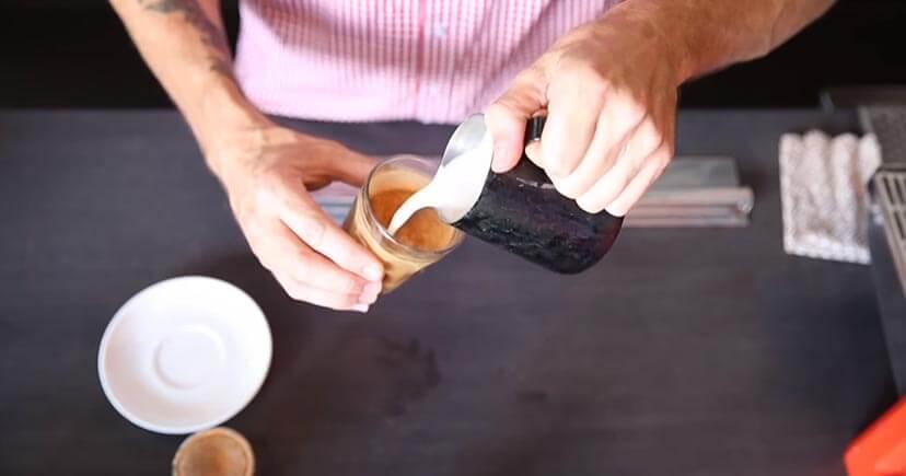 A man making Dirty Chai Latte