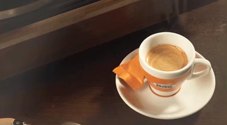 Caffe HAG coffee cup on wood table