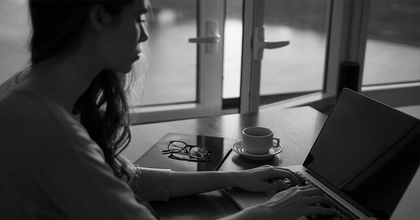 A woman work on laptop and drink coffee