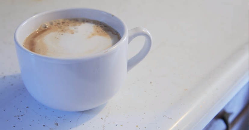 Cafe-Au-Lait in white cup on white table