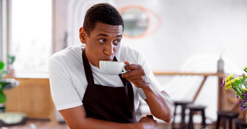 A man drinking Ristretto coffee